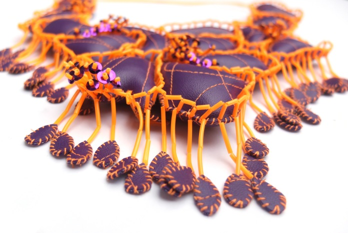 PURPLE,ORANGE AND SCOUBIDOUS(details2) -simili leather, sequins and scoubidous - handstitching and machine embroidery - VAN BIESEN Dorothée - 800£ -WCC-BF Gallery- photo Van Biesen Dor